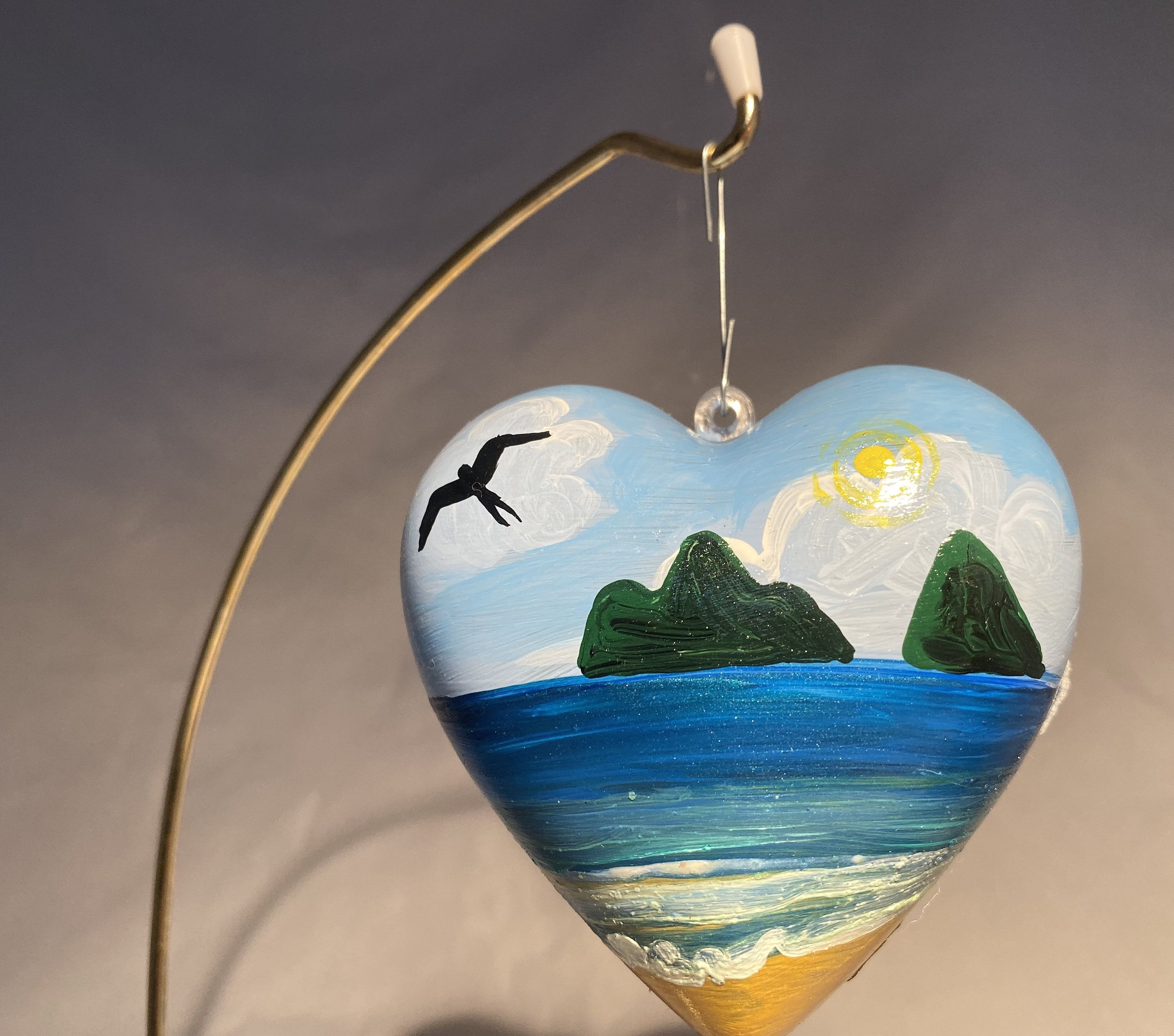 Excited to share this item from my #etsy shop: Handpainted Hawaiian Mokulua Islands on Heart shaped Christmas Ornament #christmas #mokuluaislands #oahu #hawaiiornament #melekalikimaka