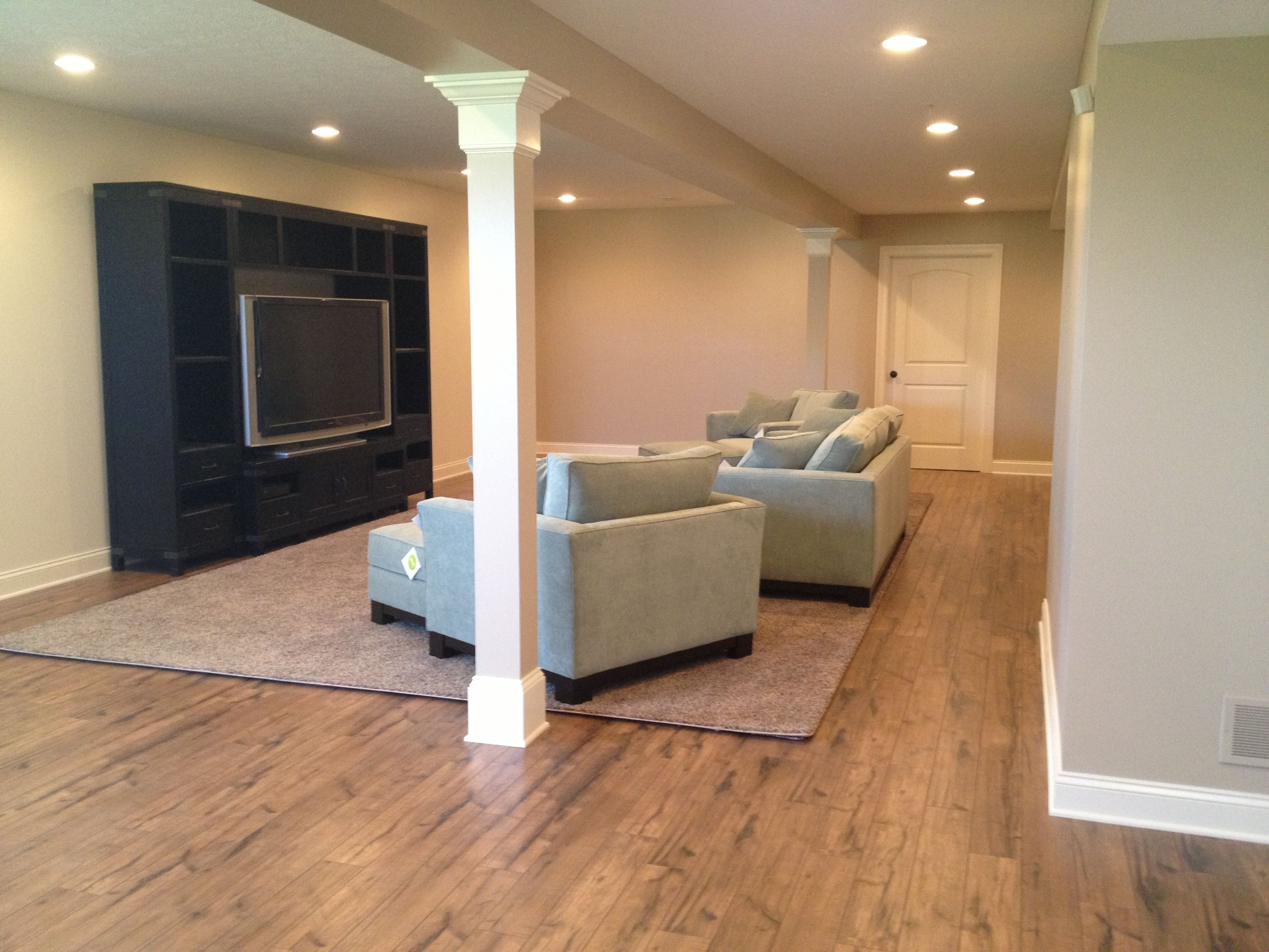 New Basement With Rustic Laminate Flooring Laminate Flooring Basement Basement Flooring Best Flooring For Basement