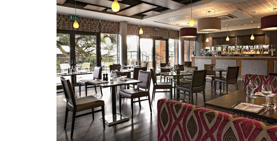 Facing the bar in The Brasserie, one of Wivenhoe House's restaurants in Colchester