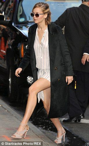 Jennifer Lawrence Displays Her Toned Legs In Chic Shirt