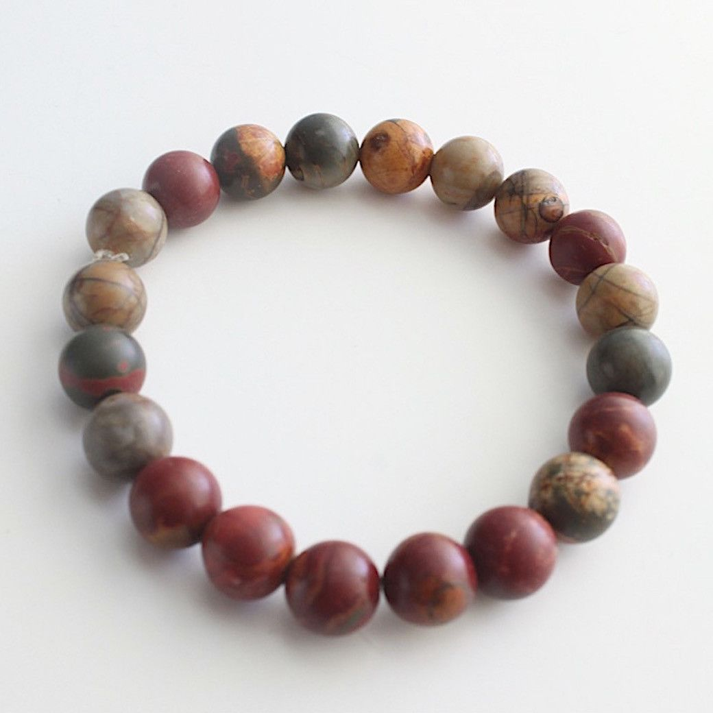 The earthy colors of Red Creek Jasper on this stretch bracelet works on any man or woman's wrist. 10 mm beads