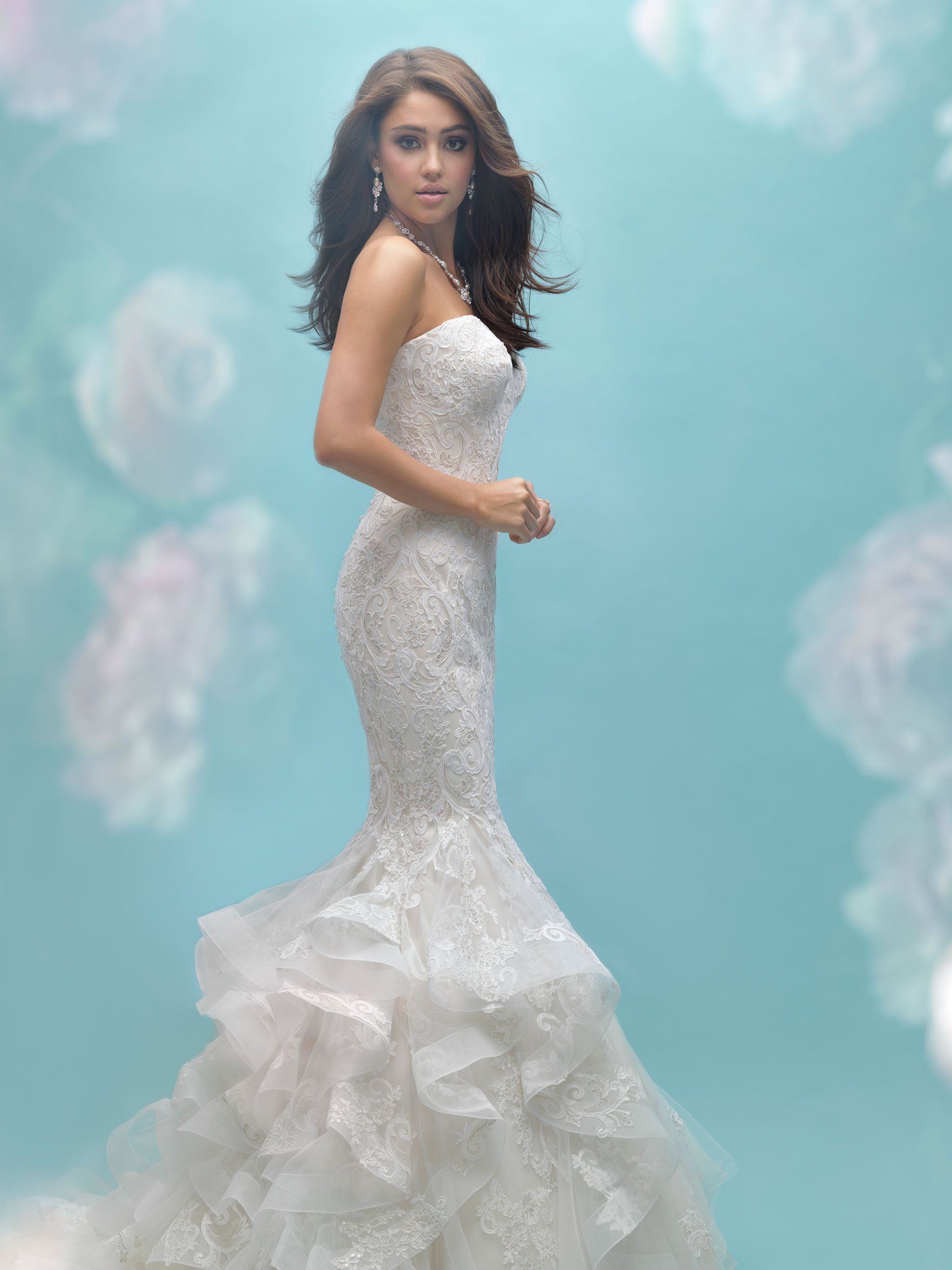 This strapless ruffled mermaid gown features symmetrical patterned ...