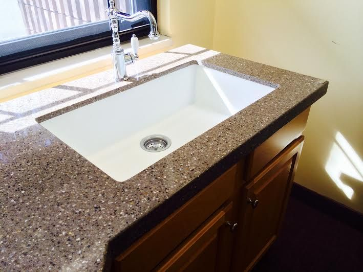 Zodiaq® Nutmeg Featured With Corian® Sink Model #966 In Glacier White