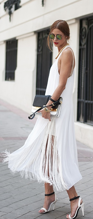 Street Style: fringed white maxi dress with black clutch and sunglasses. Love the black and white sandals.