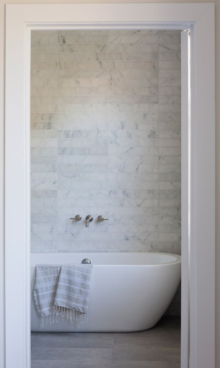 white tub, floating tub, tile wall behind tub, tub closet #bathroom ...