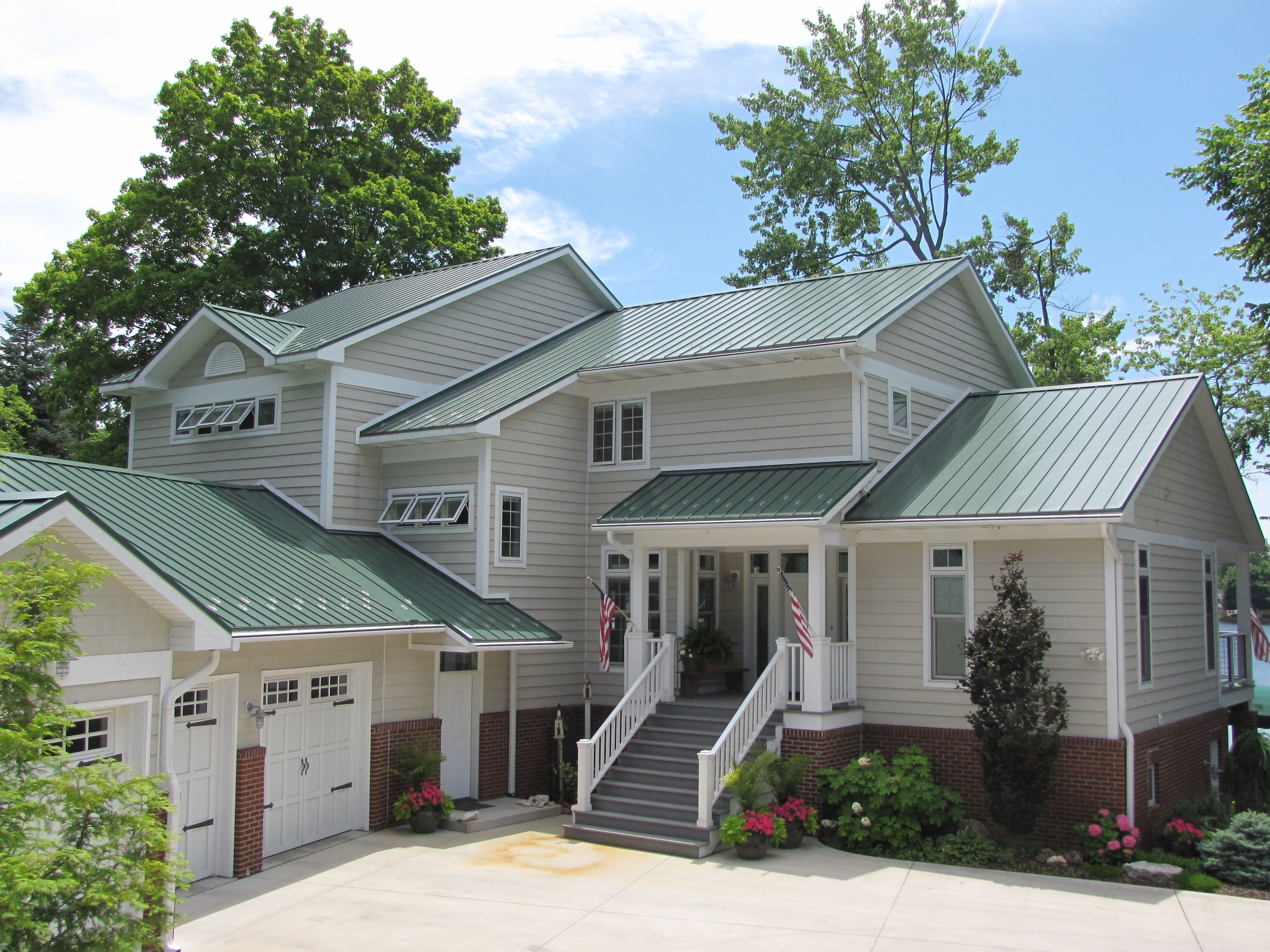 Steel Roof Metal Provided By Coated Metals Group In Classic Green Www Cmgmetals Com Project Completed By With Images Red Roof House Green Roof House House Paint Exterior