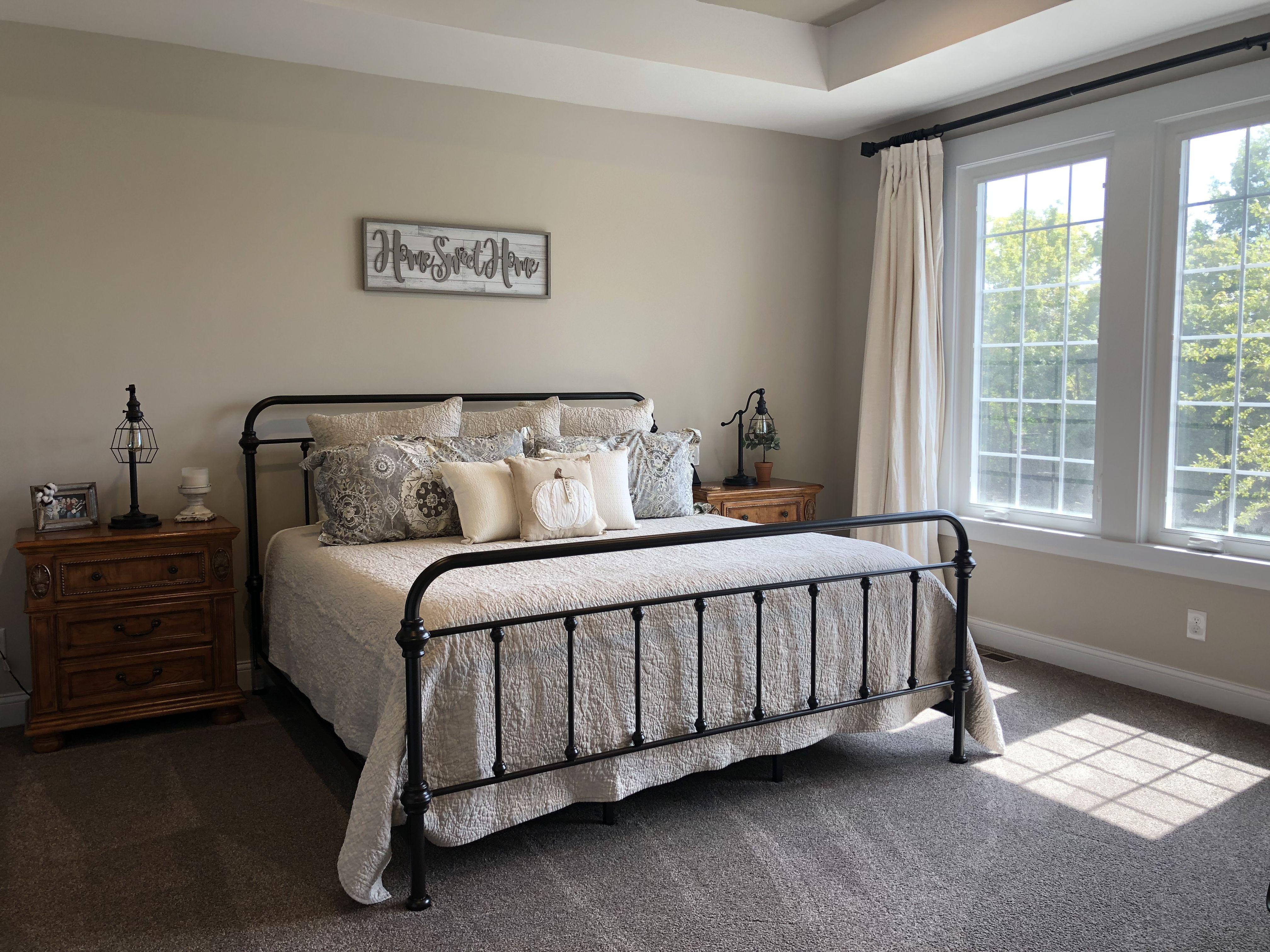 Farmhouse bed and Pottery Barn bedding. Home decor
