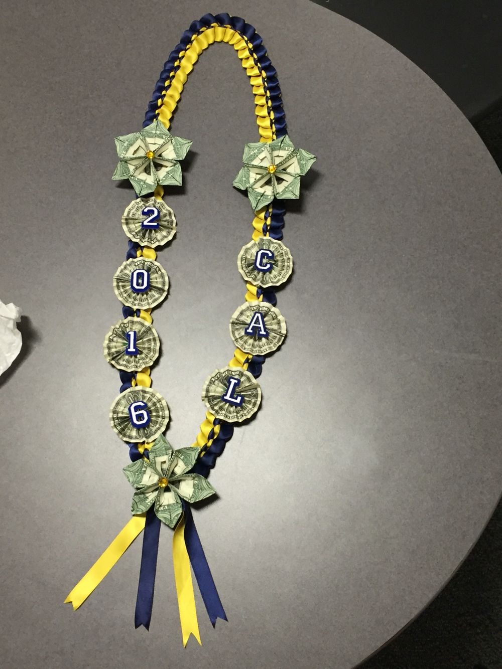 Navy blue and yellow money lei. Ready for graduation Lei