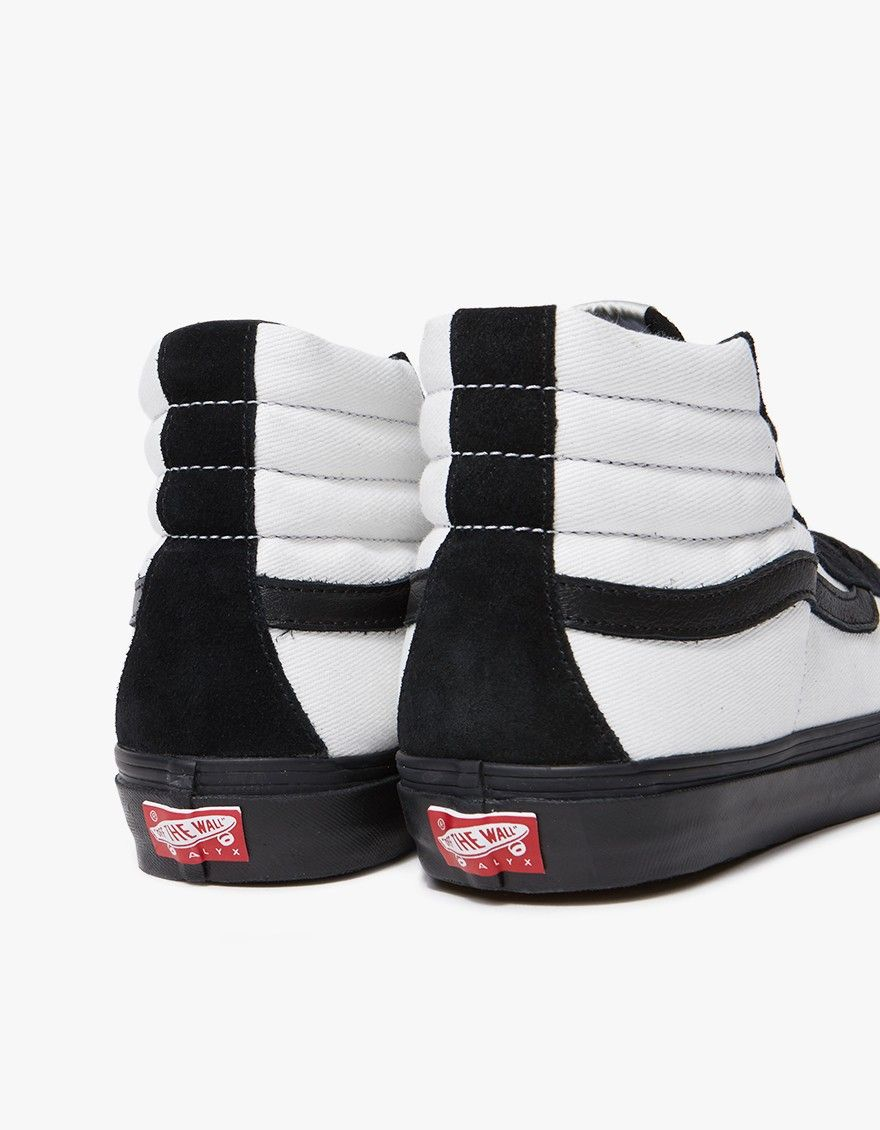 0cb2dee56d3 Classic high-top sneaker from Vault by Vans in collaboration with ALYX in Black  and White. Suede and canvas upper. Lace-up front with flat woven laces and  ...