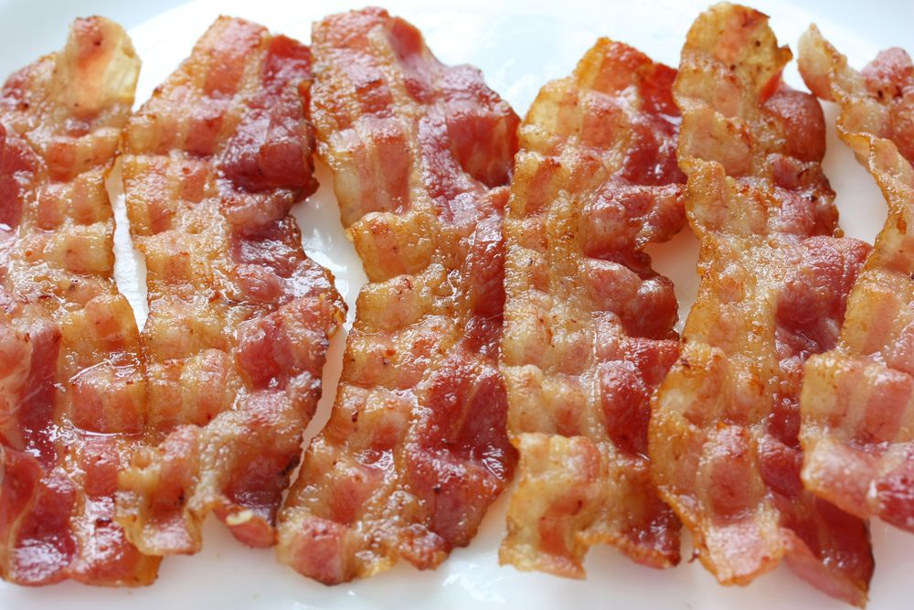 Make him the breakfast he really wants.  Bacon.  Lots of Bacon. :-)
