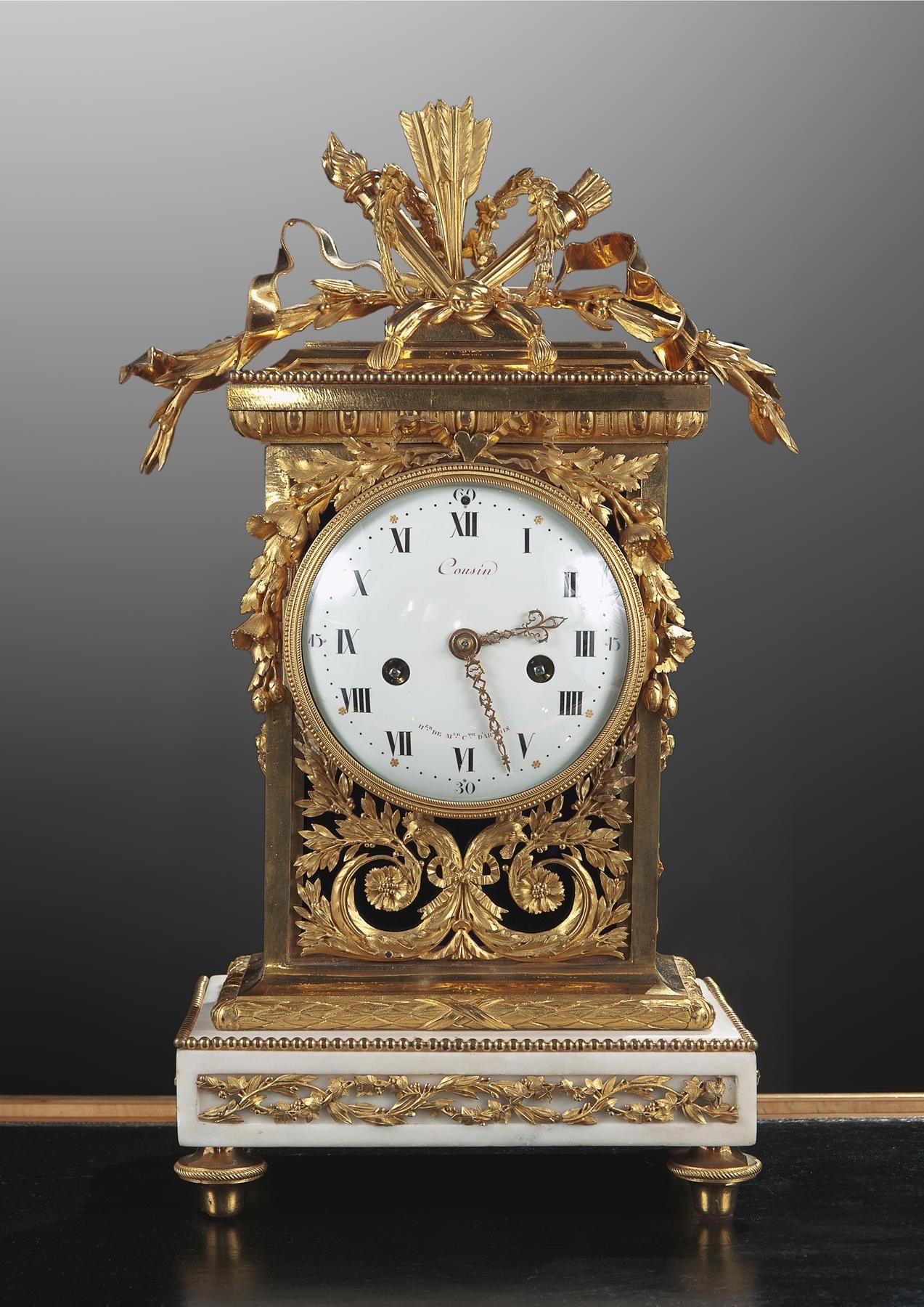 *A LOUIS XVI ORMOLU AND MARBLE MANTEL CLOCK , 18th century.