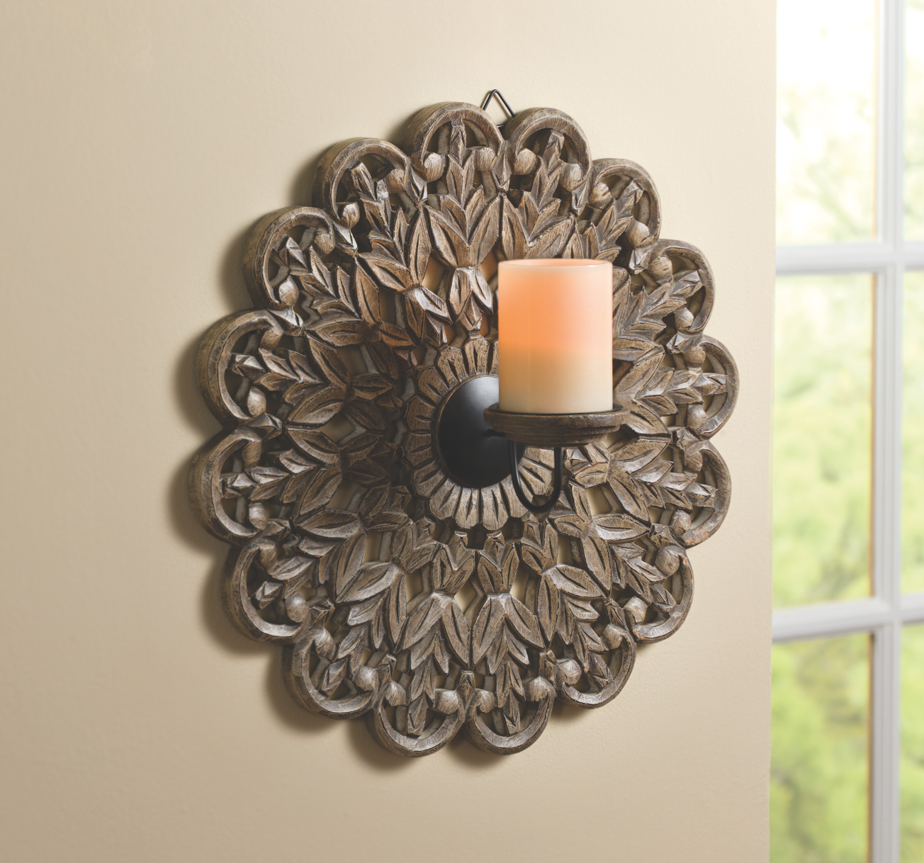 Intricately Carved Wall Candleholder ($25). Every UNICEF gift supports our lifesaving work!