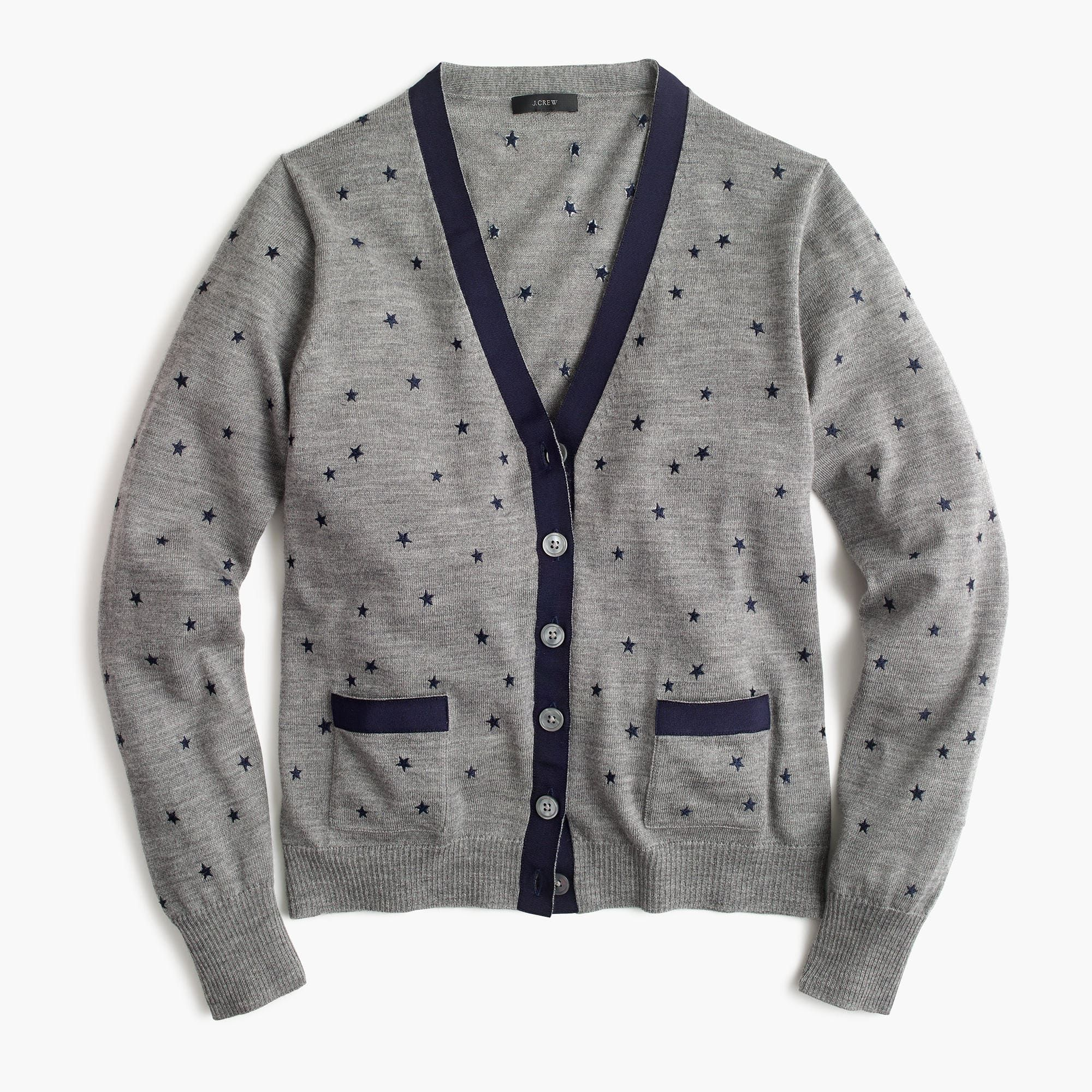 27245c20e592 A classic cardigan sweater with double pockets and polished grosgrain  ribbon tipping, plus an out-of-this-world star print. Semifitted.