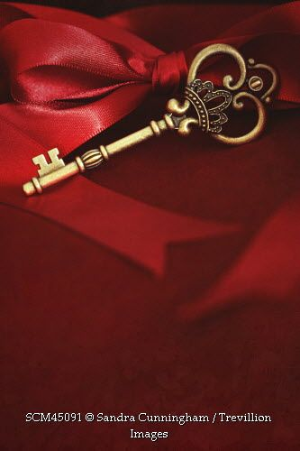 Trevillion Images Old Key And With Red Ribbon On Red