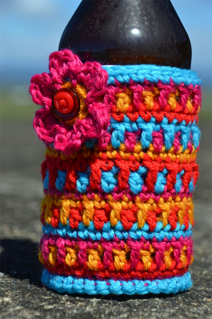 Jewel Colours Crocheted Stubbie Cooler/Bottle Cosy/Koozie with flower