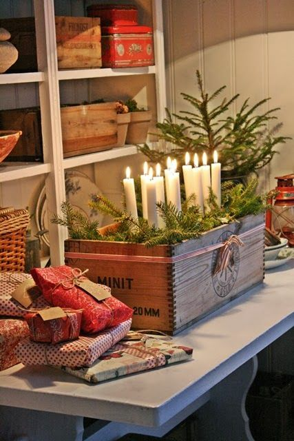 VIBEKE DESIGN christmas table with presents and candles warm and cosy. beautiful atmosphere