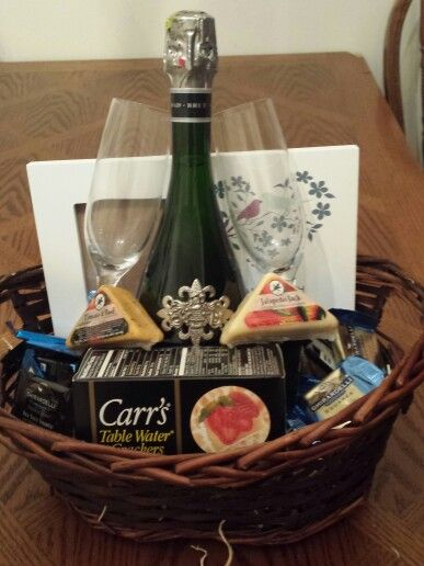 Wedding Gift Basket DIY. Cheese and crackers, chocolate and sparkling wine. Beautiful pairings for a beautiful couple! Personalized picture frame from ...