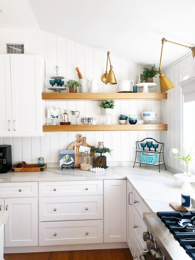 Coastal cottage kitchen in remodeled raised ranch. Open shelving with vertical shiplap backsplash. #openshelving #kitcheninspo #kitchendesign #coastalcottage #kitchendecor #kitchenlighting #whitekitchen #splitlevel #raisedranch