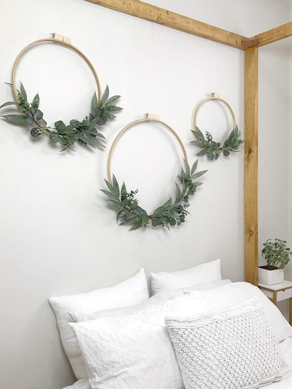 Photo of Items similar to Large Eucalyptus Wreath Set of Three. Wedding Backdrop. Nursery Wall Decor. by Oh Dina! ® on Etsy