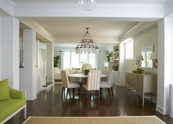 Sophisticated Open Dining Room With White Sara Chandelier Over Round Marble Top Table Surrounded By