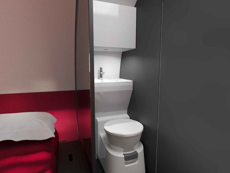 The Small Bathroom Has A Cassette Toilet Sink And Shower