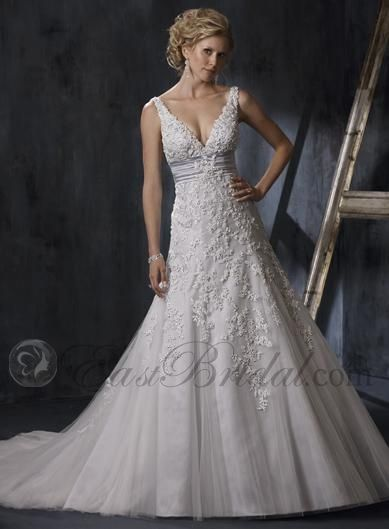 Love: deep V, lace detail  Don't love: train, fabric looks stiff on top, straps too wide