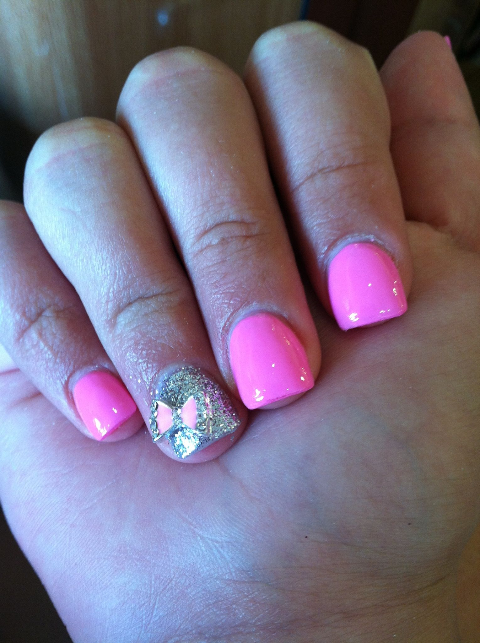 pink acrylic nails • sparkle silver nail • pink diamond-edge bow