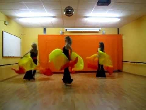 http://m.youtube.com/watch?v=z45o3mAoJqQ   Excellent group routine with minimal dance and focus on the veils. Love this one.