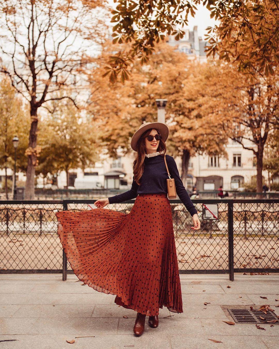 Autumn everywhere. The pleated skirt plumes like a peacock