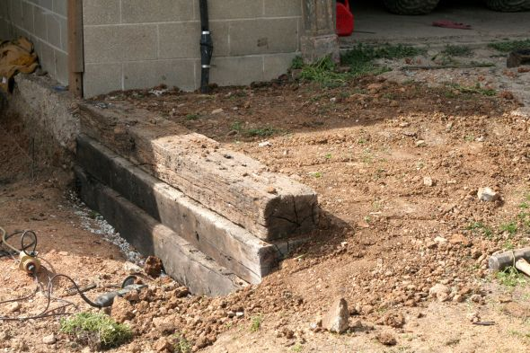 How To Build A Railroad Tie Retaining Wall Building A Retaining Wall Landscaping Retaining Walls Diy Retaining Wall