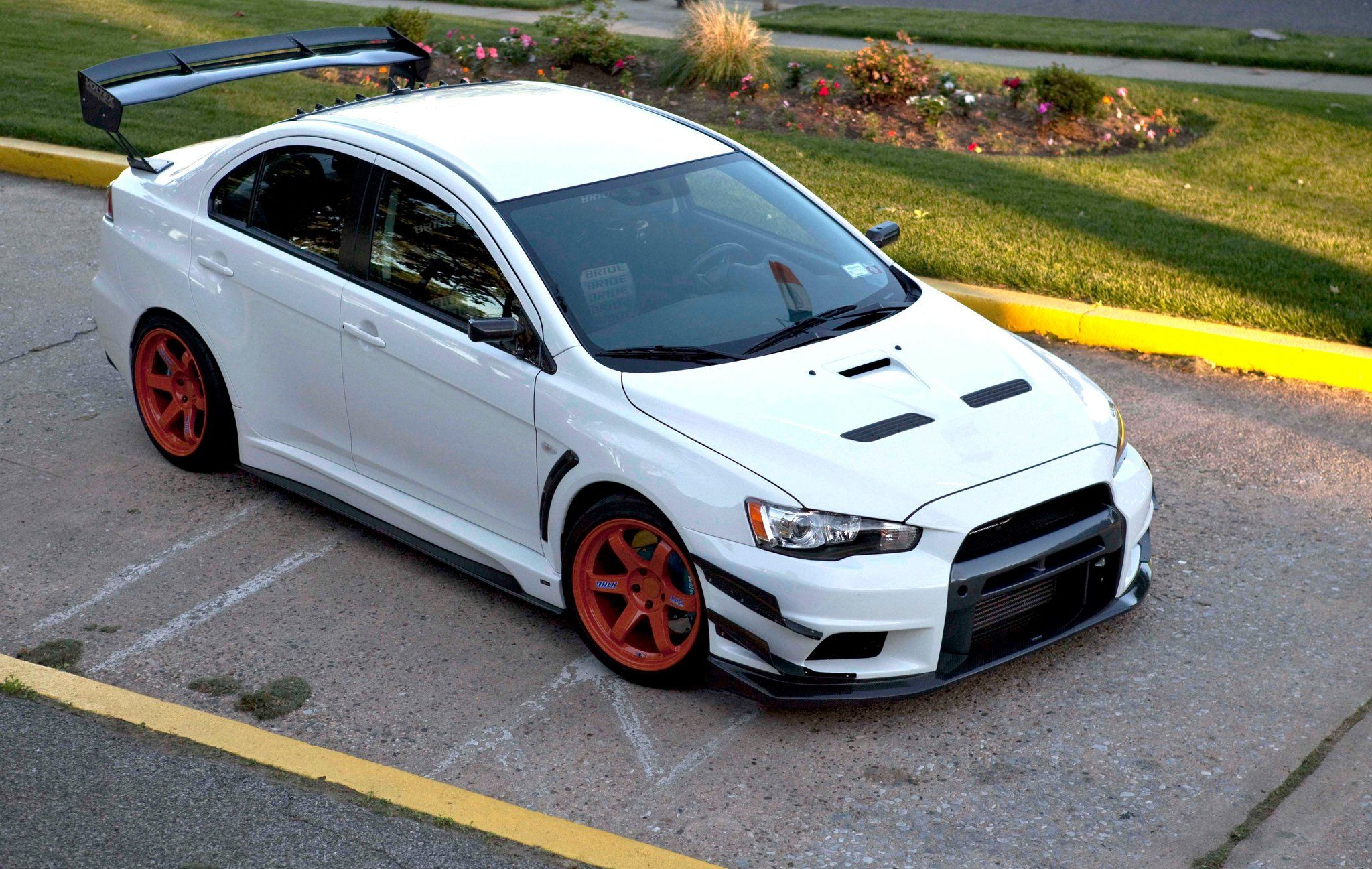 mitsubishi lancer evo 10 mitsubishi lancer evo 10 sport car white edit front side