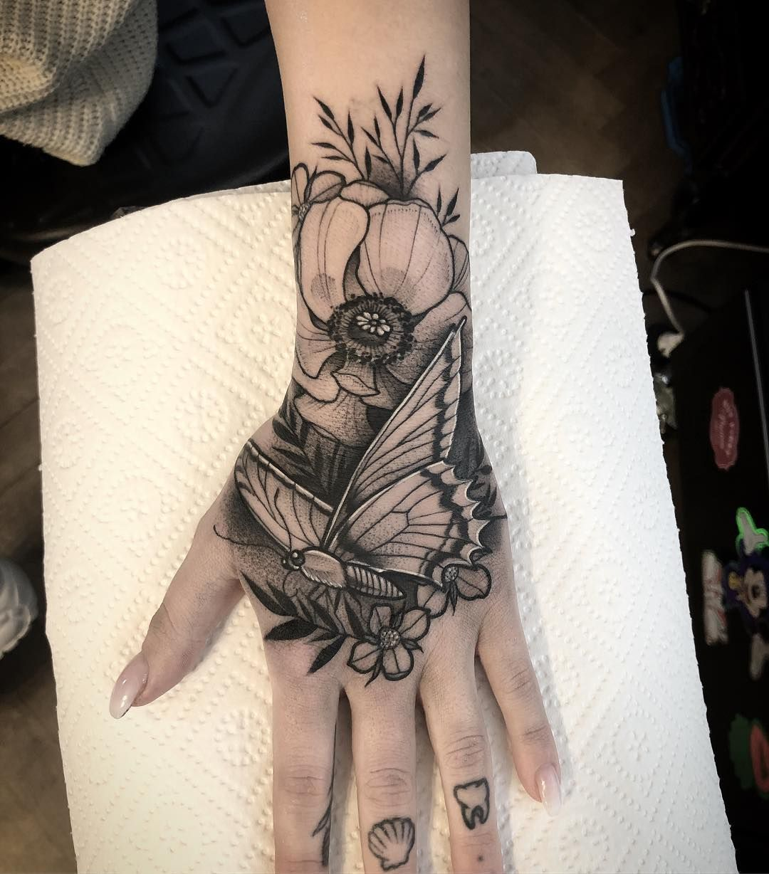Another One And I Want More Blacktattoo Tattoo Tattoos Hand Handtattoo Butterfly Flowers F Hand Tattoos Hand Tattoos For Women Hand Tattoos For Guys