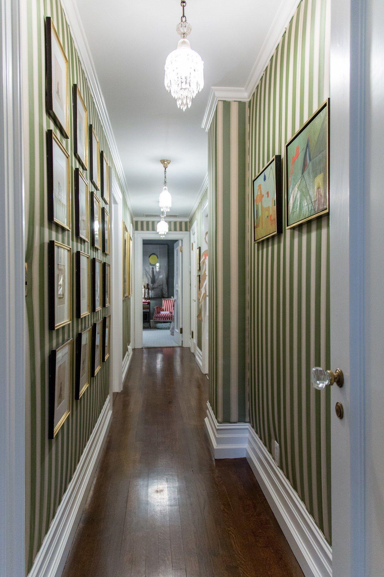 Narrow hallway decor  Narrow Hallway With Striped Walls And Framed Arts Decorating Ideas