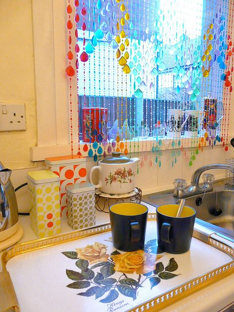 Vintage kitchen with beads hanging in the window....so cute ...