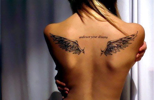 Back Wing Tattoo Female Typically She S Very Melancholy Sitting