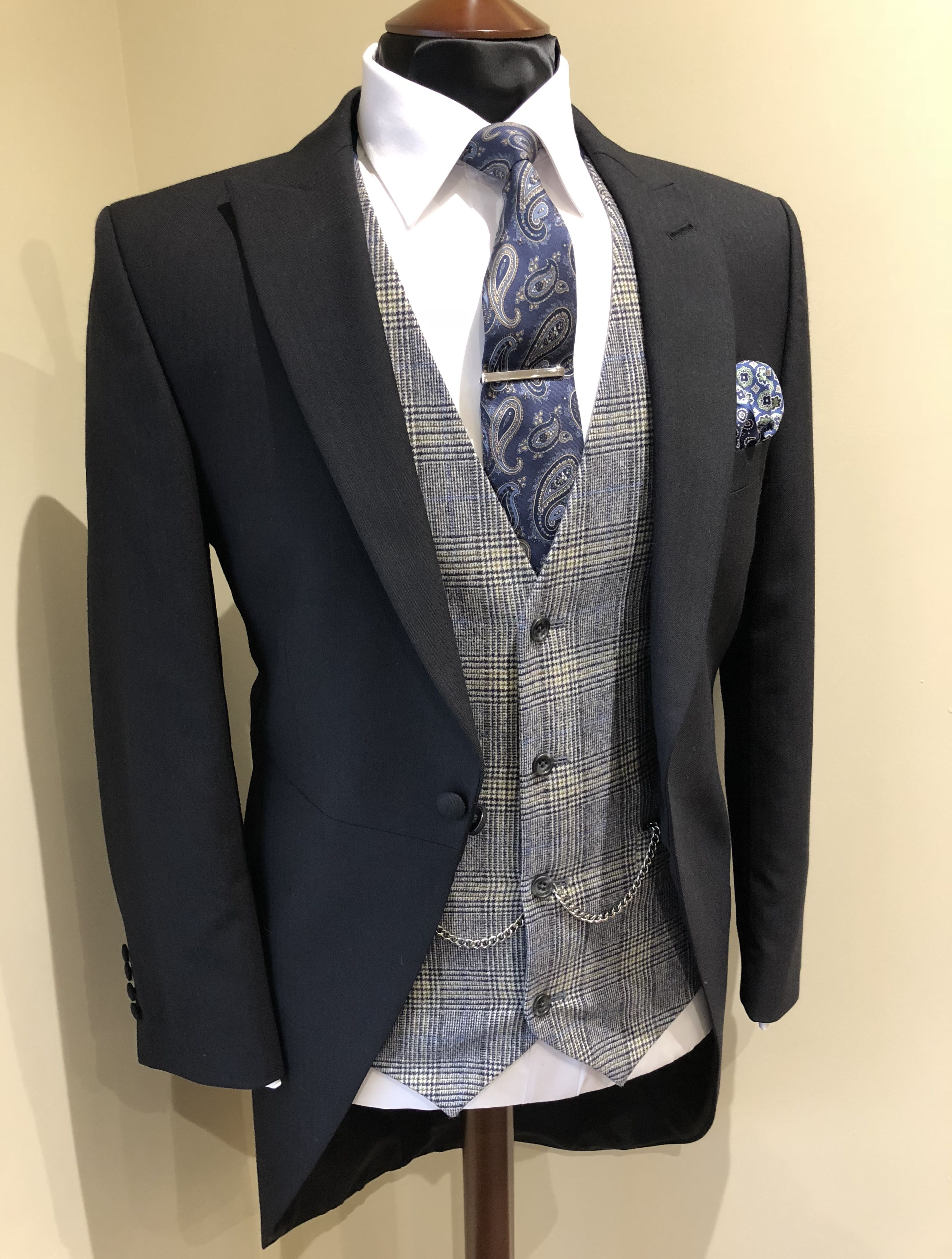 Black morning suit with flannel check waistcoat & paisley