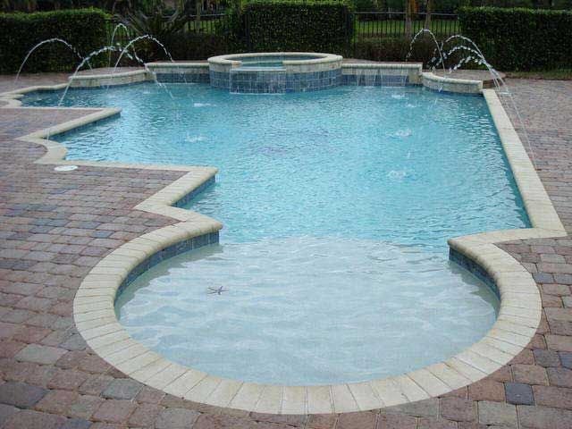 Unique pool shape awesome inground pool designs for Pool design unique