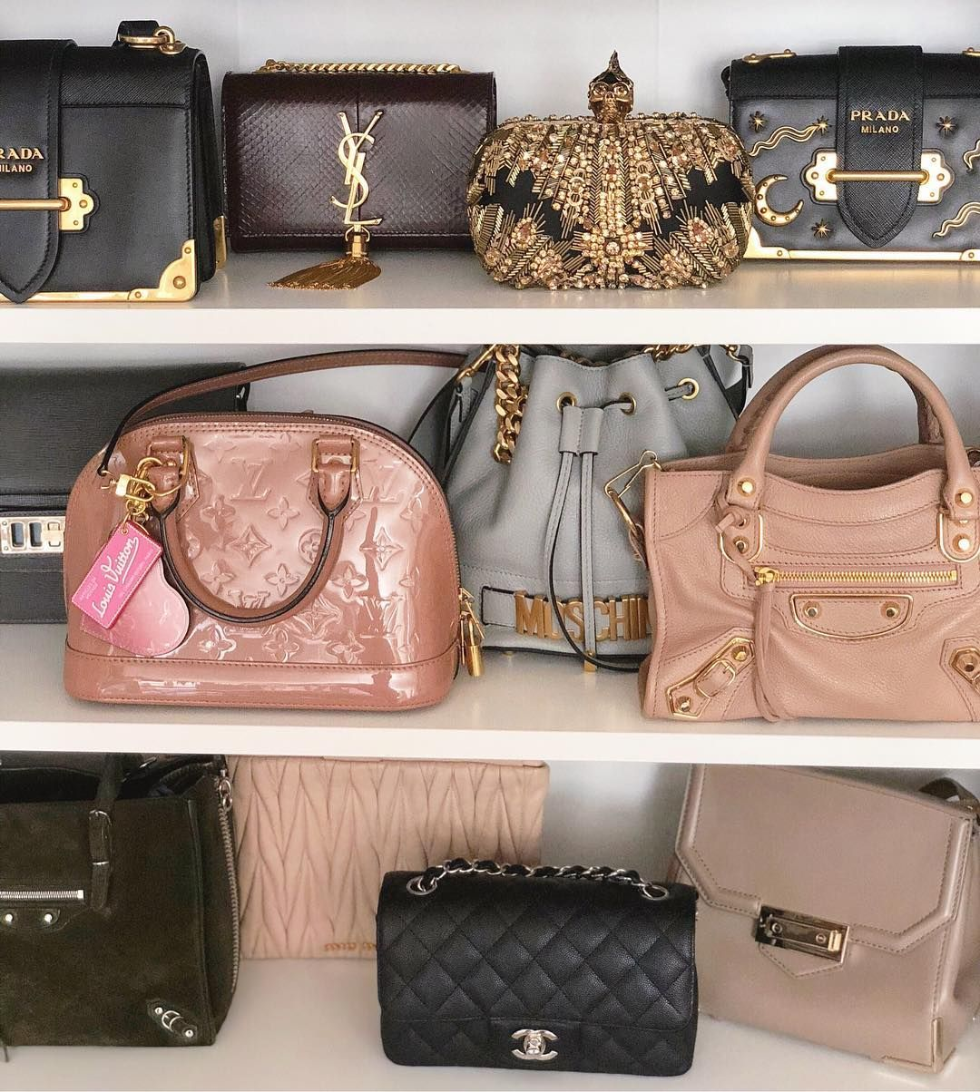 78403a756600 Some of my designer handbag collection: Prada Cahier, YSL Kate snakeskin  monogram clutch, Alexander McQueen embellished skull clutch, Prada  astrology star ...