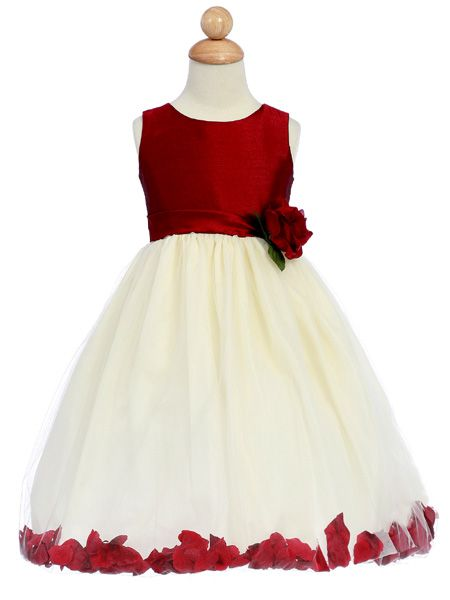 8d85afce5b7 Pretty flower girl dress with a faux silk bodice and fluffy tulle skirt  with floating petals in the hemline There is a fixed sash to the waist with  a