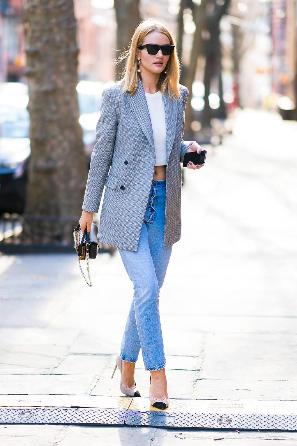 4868f3be2f Rosie Huntington-Whiteley in a Calvin Klein blazer with a Fendi handbag and  Saint Laurent shoes.