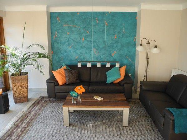 Wandgestaltung in Türkis im Wohnzimmer Schmuckwand Wischtechnik - wandgestaltung mit drei farben