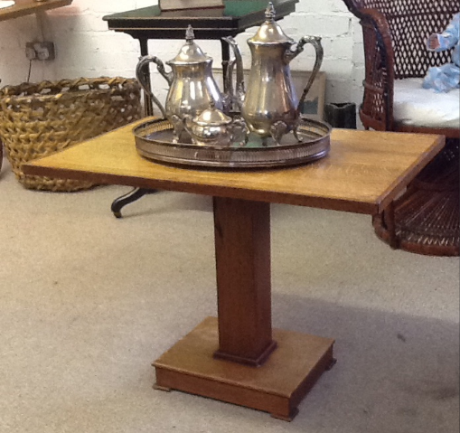 Art Deco tilt top table. Table top measures 29 inches x 18.5 inches. Height measures 21 inches.