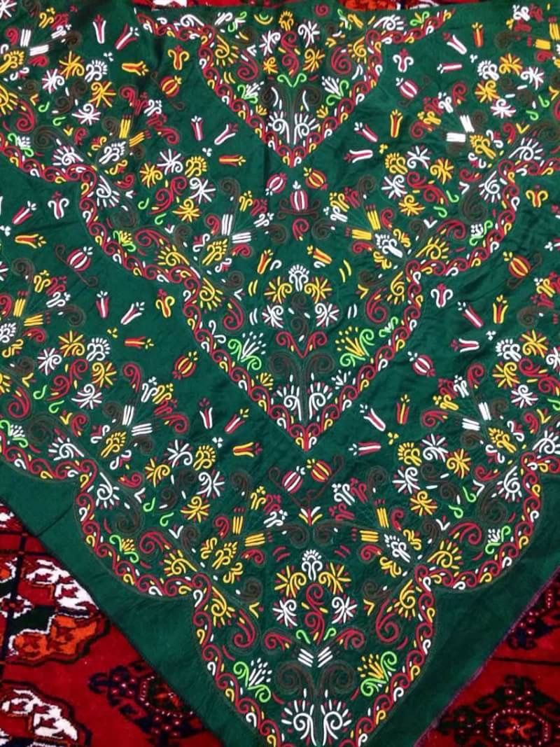 Ornaments on woman shawl