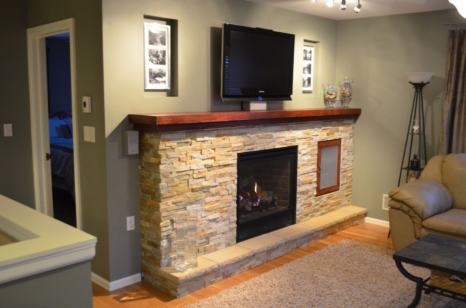 Natural Stone Fireplaces Unwinding Simpleness A Tall Amazing Fireplace Is The Focal Point Of Th Fireplace Design Christmas Fireplace Decor Fireplace Decor