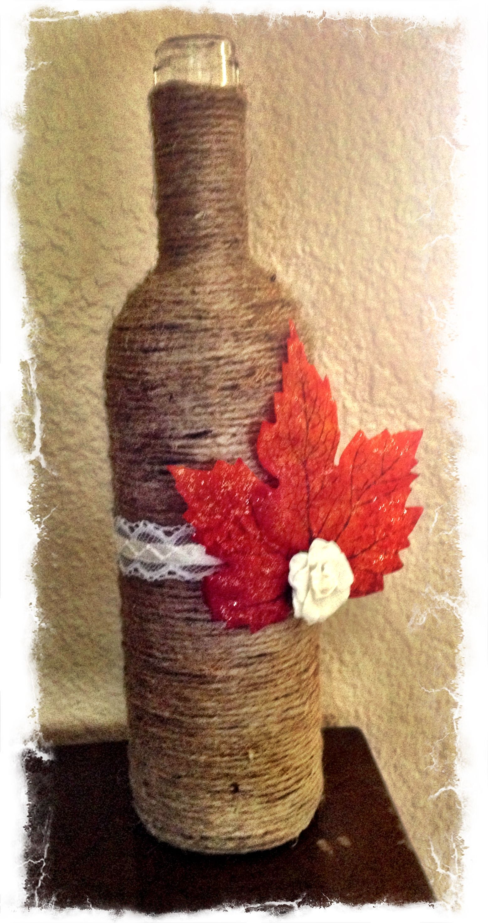 Jute Twine Wrapped Wine Bottle With Flowers Mason Jar Lights Little Pumpkins And Pincecone Na Wine Bottle Crafts Wine Bottle Diy Crafts Wrapped Wine Bottles