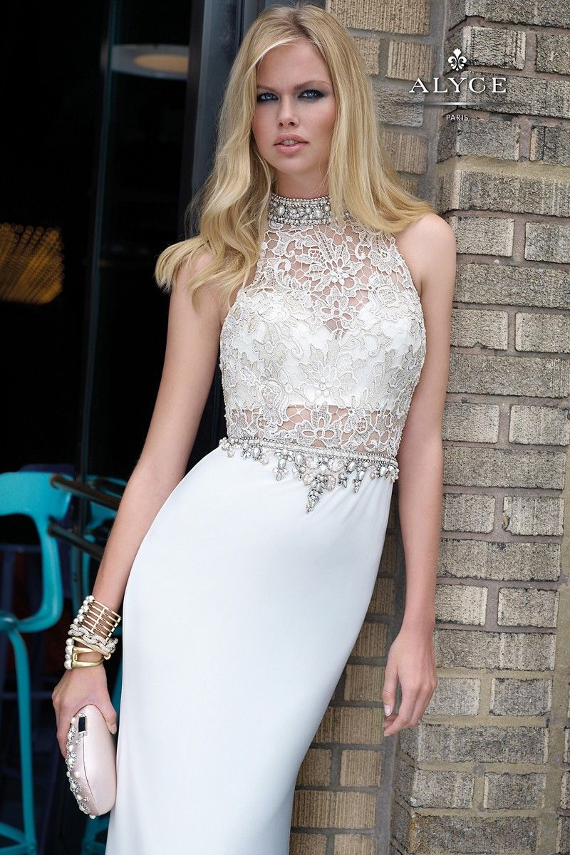 The detail on this dress is sure to catch everyone's attention, a lace bodice with stones along the neckline and waist.