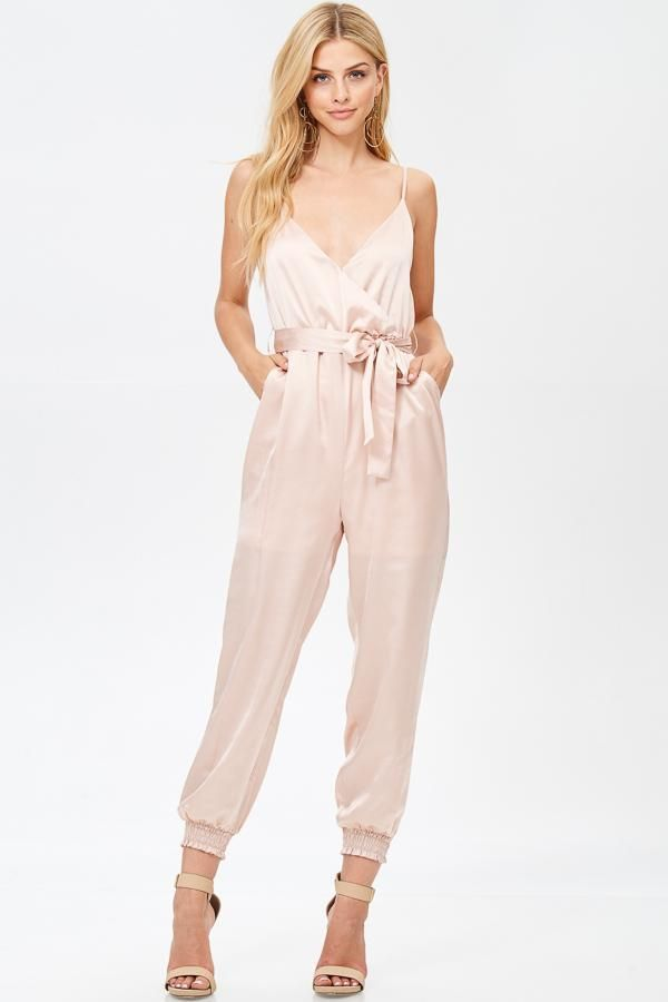 c701131c9b2 Satin jogger jumpsuit with a surplice front and snap button closure