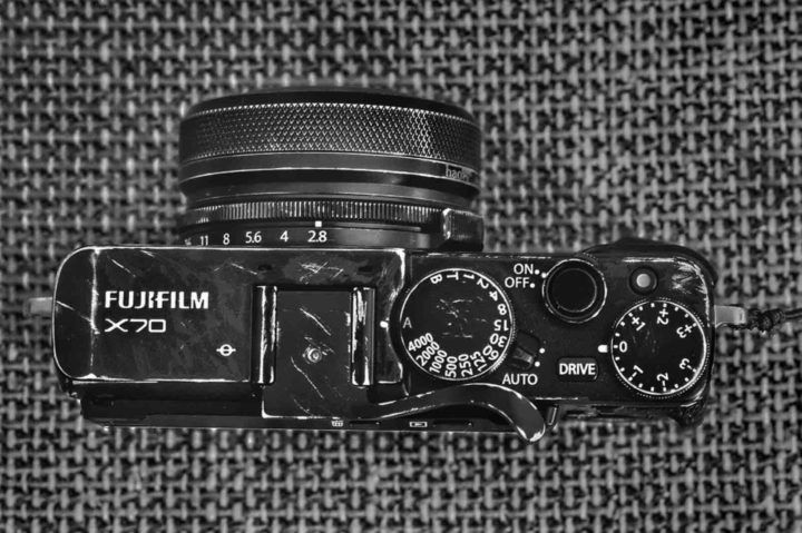 Fujifilm X80: Kevin Mullins Explains Why he Needs One after Damaging his Fujifilm X70  Fujifilm XF10  Yes I know here on FujiRumors we already told you about the Fujifilm XF10 a camera similar in size to the X70 and yet it cant be considered an XF10 successor because it has no X-Trans sensor and especially because it has not a Selfie Screen.  Considering the XF10 without Selfie screen a successor to the X70 would be like considering the X-Pro3 without hybrid viewfinder a successor to the X-Pro2.  And indeed the fact that Fujifilm decided to give the camera an all new name and not X70s or X80 is indication that Fujifilm itself wont market it as a real X70 successor.  I am sorry guys for as much love I have for Fujifilm I simply cant understand this camera.  And since I am not at all part of Fujis marketing machine but I write what I want when I want with the same freedom of when I started this blog 6 years ago I will use my freedom to criticise the XF10.  However even though I am on holidays I will live blog on July 5th to cover the Fujifilm XF10 launch.  Fujifilm X80  The only worthy successor to the X70 should be called X70s or X80.  At this stage I have no information if Fujifilm has plans to make an X80 or not. But there are people who certainly hope it will see the light of the day such as Kevin Mullins.  After seriously damaging his Fujifilm X70 a camera that Kevin Mullins really likes and uses also for his pro work at weddings Kevin started crossing his fingers for an X80.  He shared a video on his youtube channel here explaining why he needs an X80 and what improvements he would like to see over the X70 as well as a blog post at f.16 click where he shares lots of beautiful images taken with his X70.  Of course Kevin needs the selfie screen actually he even wants a fully articulating one.  Kevin Mullins shared another X70 video here: People Watching at Cheltenham Races 2018 with my Fuji X70  Self Scratched X70  And while Kevin Mullins accidentally damaged his 