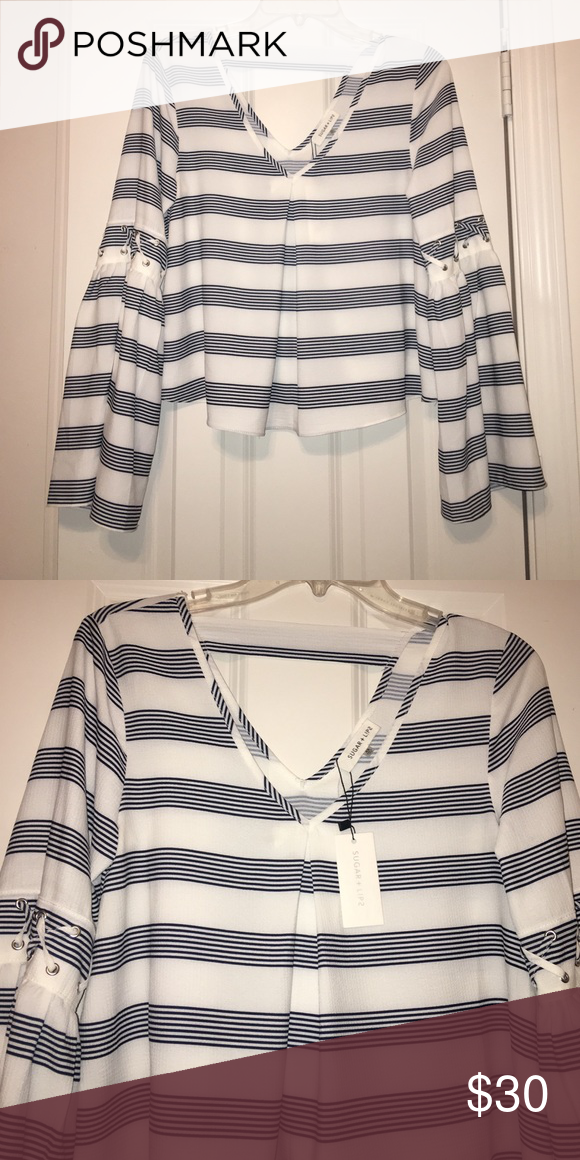 New boutique top New with tags flowy top. Stripes are a navy blue sugar + lips Tops Tees - Long Sleeve