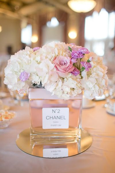 obsessed with this bridal shower centerpiece perfect for chanel fans